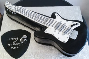 Sculpted electric guitar cake by Eat My Sweets Bakery